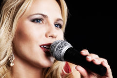 Beautiful singer. A beautiful singer with a microphone Stock Image