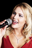 Beautiful singer with microphone Royalty Free Stock Photos