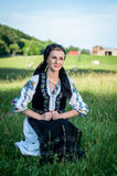 Beautiful singer posing in traditional costume, romanian f Stock Images