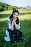 Beautiful singer posing in traditional costume, romanian f Stock Photo