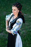 Beautiful singer posing in traditional costume, romanian f Royalty Free Stock Photos
