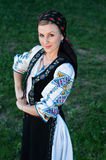 Beautiful singer posing in traditional costume, romanian f Royalty Free Stock Photo