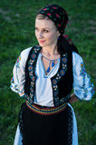 Beautiful singer posing in traditional costume, romanian f Stock Photography
