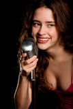 Beautiful singer singing with microphone Royalty Free Stock Photography
