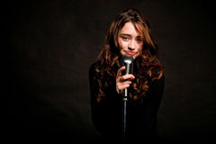 Beautiful singer singing with microphone Royalty Free Stock Image