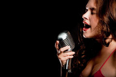 Beautiful singer singing with microphone Royalty Free Stock Photos