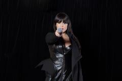 Beautiful singer singing Stock Photos