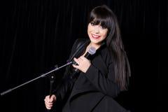 Beautiful singer singing Stock Images