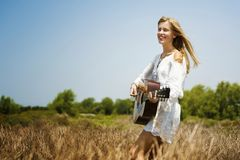 Beautiful singer songwriter with her guitar stock images