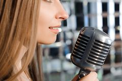 Beautiful Singing Girl. Beauty Woman with Microphone. Glamour Model Singer. Karaoke song. Beautiful Singing Girl. Beauty Woman with Microphone. Glamour Model stock photography