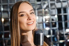Beautiful Singing Girl. Beauty Woman with Microphone. Glamour Model Singer. Karaoke song. Beautiful Singing Girl. Beauty Woman with Microphone. Glamour Model stock photo