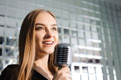 Beautiful Singing Girl. Beauty Woman with Microphone. Glamour Model Singer. Karaoke song. Beautiful Singing Girl. Beauty Woman with Microphone. Glamour Model royalty free stock photography