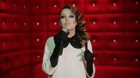 Beautiful Singing Girl. Woman with Microphone. Karaoke song stock video