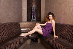 Beautiful single woman sitting in wet hammam room and smiling Royalty Free Stock Image