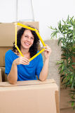 Beautiful single young woman  into a new home. Stock Image