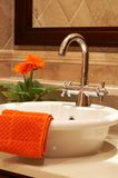 Beautiful sink in a bathroom. With towel on it and a flower Stock Image