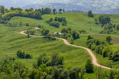 Beautiful sinuous road in Bucovina rural area, Romania royalty free stock images