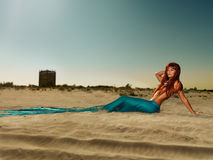 Beautiful siren on sandy beach Stock Image