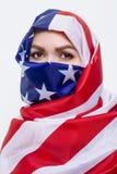 Beautiful Sirian woman wearing a hijab from the American flag. Beautiful Arab woman wearing a hijab from the American flag royalty free stock image