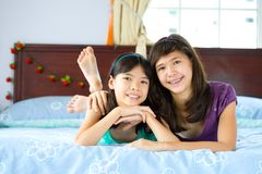 Beautiful sisters enjoying being at home Royalty Free Stock Photo