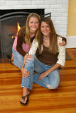 Beautiful Sisters By Fireplace Royalty Free Stock Photo