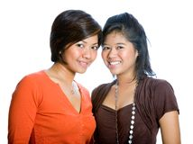 Beautiful sisters in orange and brown top. Stock Photo