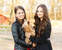 Beautiful sisters with pet dog Stock Photography