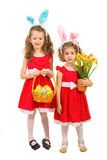 Beautiful sisters in red dresses Stock Images