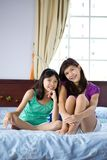 Beautiful sisters relaxing at home Stock Photo