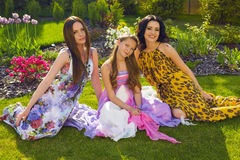 Beautiful sisters relaxing at summer garden Stock Photography