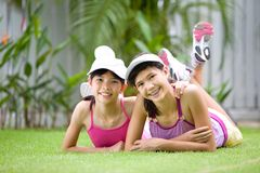Beautiful sisters in sporty outfit enjoying the ou Stock Photo