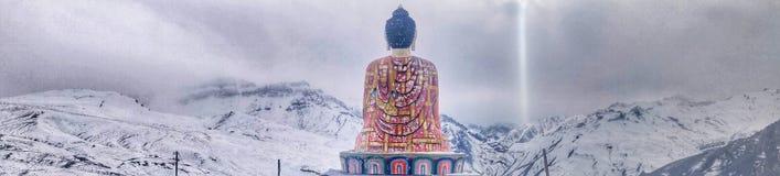 Beautiful sitting Buddha and beautiful nature and snow white stock image