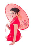 Beautiful sitting girl in red japanese dress with umbrella isola Stock Photos