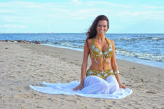Beautiful sitting woman in exotic dress Royalty Free Stock Photography