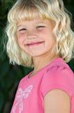 Beautiful six year old girl. A beautiful, cherubic six year old blond girl royalty free stock photo