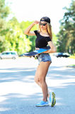 Beautiful skater woman - outdoor fashion portrait Royalty Free Stock Images
