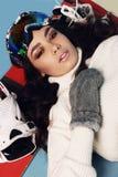 Beautiful skier girl with dark hair wears  ski equipment. Fashion studio photo of beautiful skier girl with dark hair wears  ski equipment Stock Photo