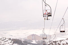 Beautiful Skier Lift Up On Chairlift