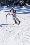 Beautiful skier skiing on the slope Stock Images