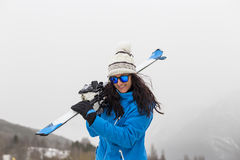Beautiful Skier woman on top of the mountain. Fog. Winter season. Sports concept Stock Photography