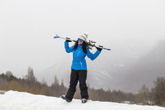 Beautiful Skier woman on top of the mountain. Fog. Winter season. Sports concept Royalty Free Stock Photography