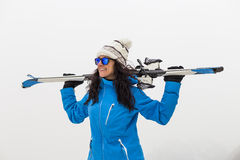 Beautiful Skier woman on top of the mountain. Fog. Winter season. Sports concept Royalty Free Stock Photo