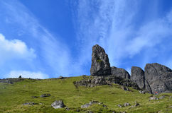 Beautiful Skies Over the Old Man of Storr. Pretty landscape and blue skies with streaking clouds over rocks at the Old Man of Storr Stock Photos