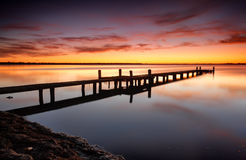Beautiful skies over Tuggerah Lake with old jetty Royalty Free Stock Photos