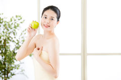 Beautiful skin asian woman towel wrap holding fresh apple Royalty Free Stock Photo