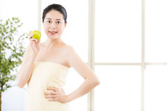 Beautiful skin asian woman towel wrap holding fresh apple Royalty Free Stock Images