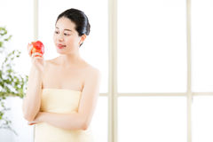 Beautiful skin asian woman towel wrap holding fresh apple Stock Photography