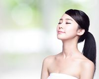 Beautiful Skin care woman Face. Smile and enjoy carefree  on nature green background. asian Beauty Royalty Free Stock Images