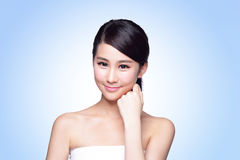 Beautiful Skin care woman Face. Smile to you  on blue background. asian Beauty Stock Photo