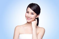 Beautiful Skin care woman Face. Smile to you  on blue background. asian Beauty Stock Images
